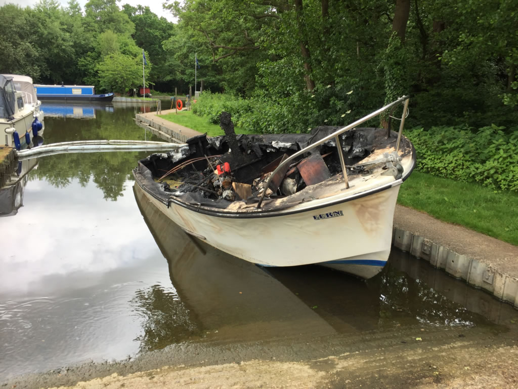 Burnt-out Freeman 22 River Boat Scrap Along Side