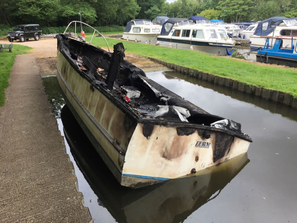 Scrap a Boat - A Burnt out narrowboat ready to be scrapped.