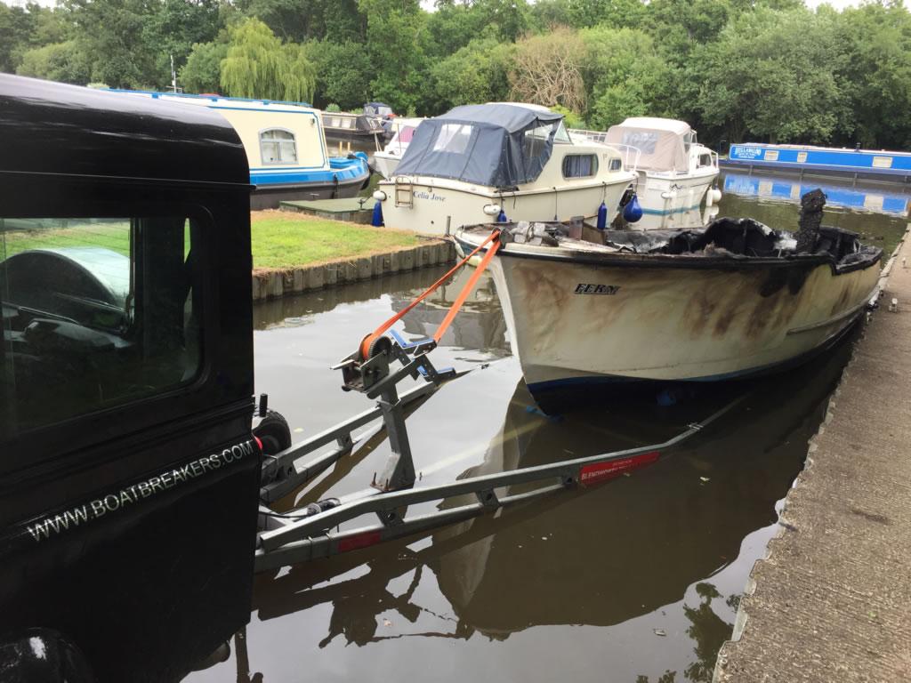 Burnt-out Freeman 22 River Boat Scrap - Loaded unto trailer