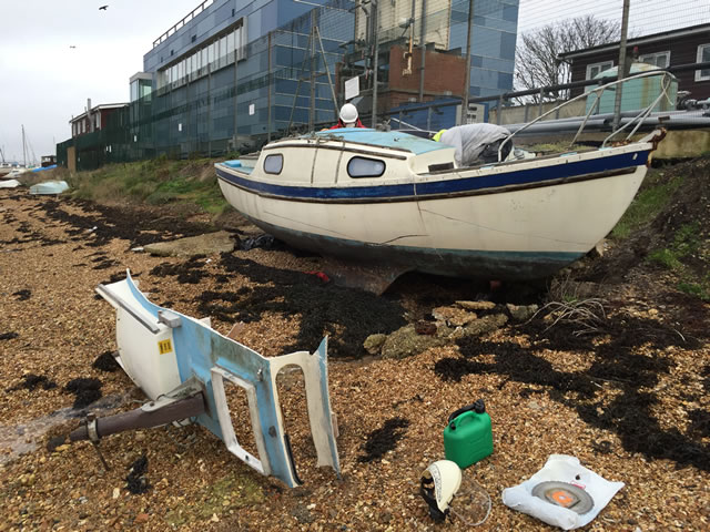 The Issues of Boat Disposal - A Fibreglass Yacht being cut up by hand
