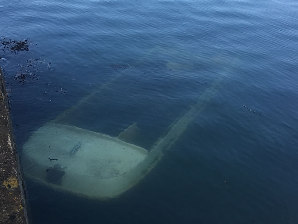 Recovering a Sunken Motorboat in Plymouth.
