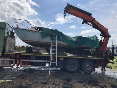 Abandoned Yacht Collection Saga - Burnt yacht on the transport