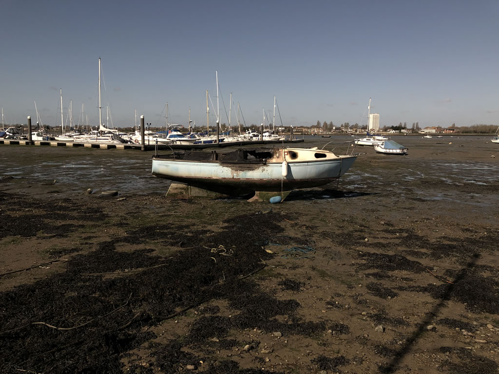Abandoned Yacht Collection Saga - Burnt out yacht waiting for collection.