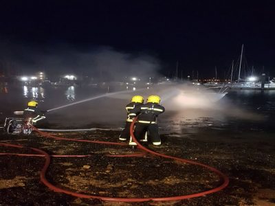 Abandoned Yacht Collection Saga - Fire Crews putting out the boat fire