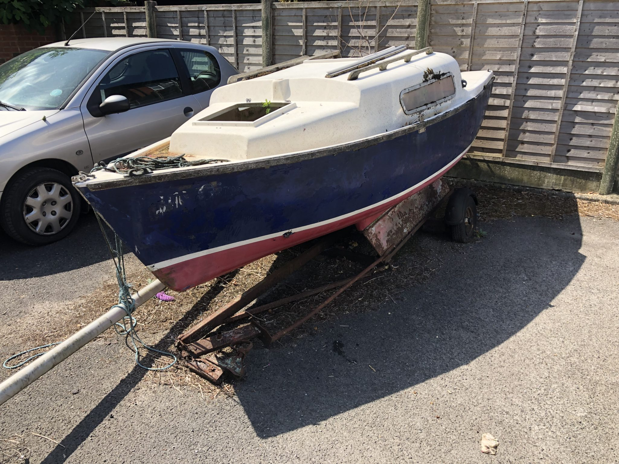 Scrap Yacht in a Car Park Collected From Lymington