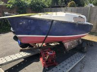 Scrap Yacht from a Lymington Car Park being loaded onto a trailer