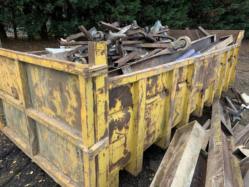 Boat Moulds Disposal - Bin Full of Scrap Metal