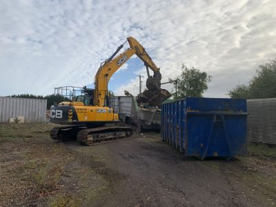 Boat Moulds Disposal - Loading into a bin