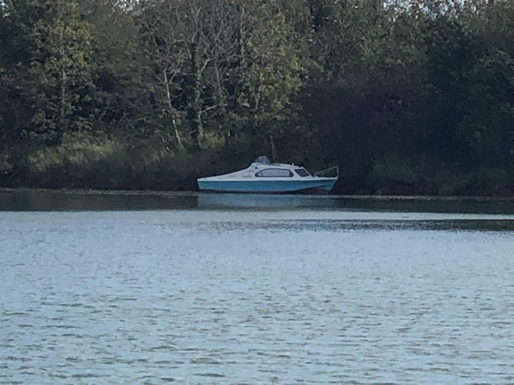 Derelict Motor Boat on Shoreline