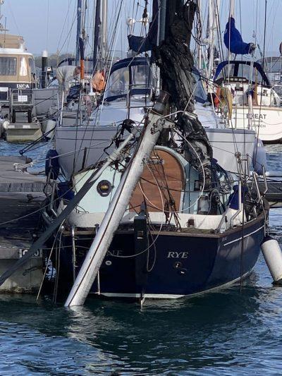 Sunken Yacht Mast Rest on Burnt Boat