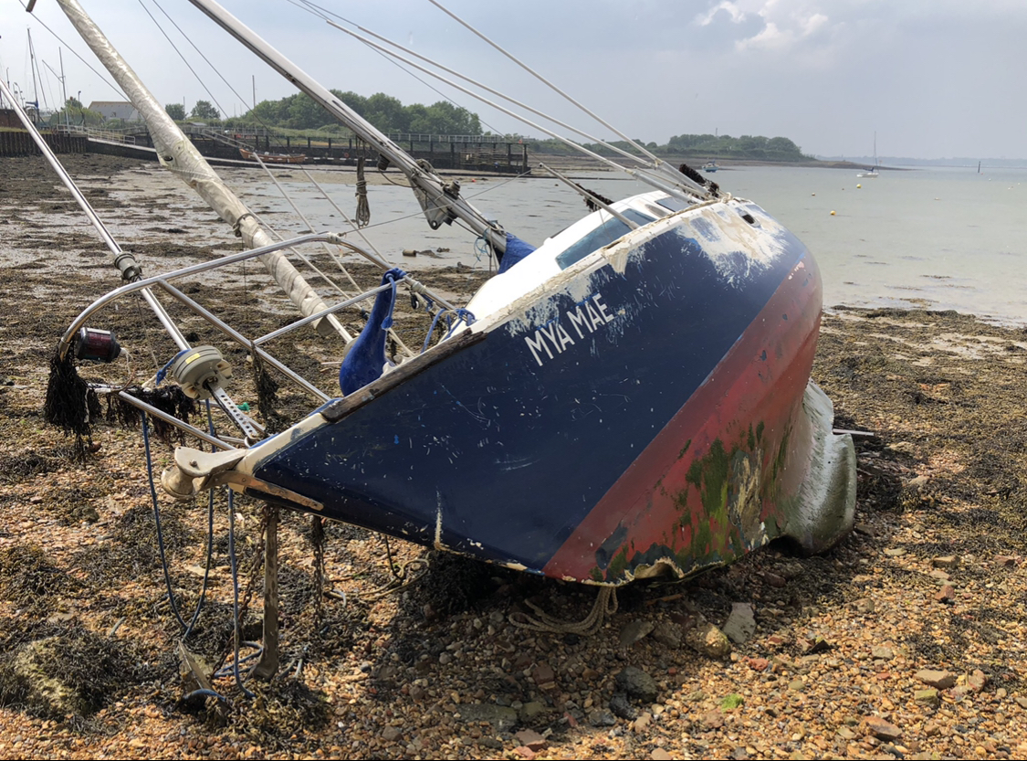 Wrecked FRP Yacht in Portsmouth Harbour