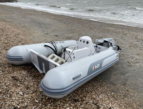 Boatbreakers Team Salvage Stricken Boat on a Beach